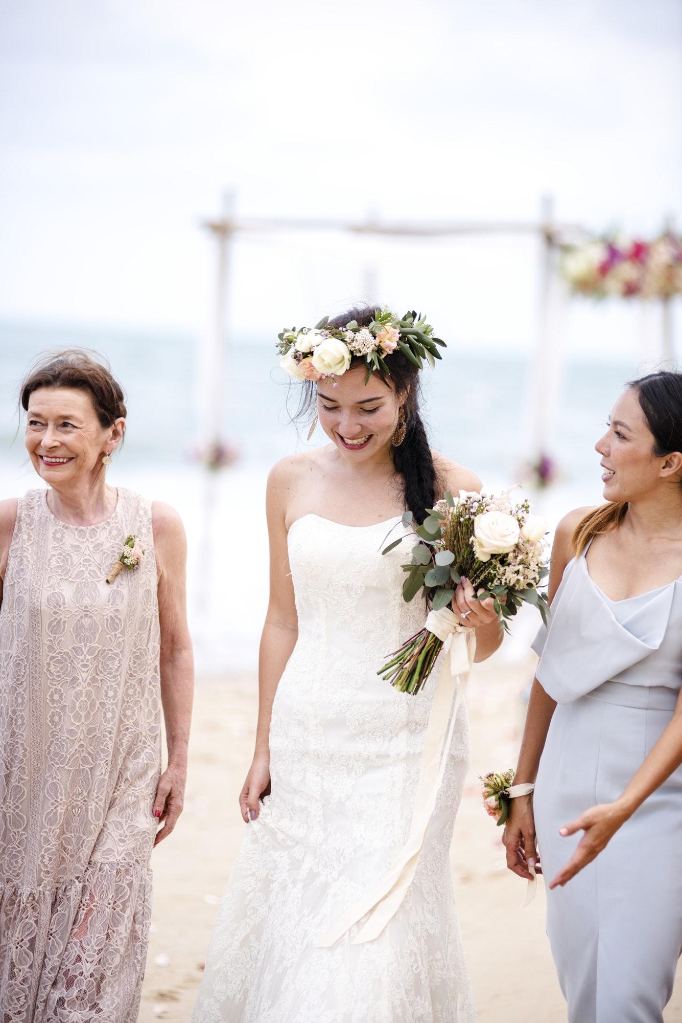 Cheerful bride at the beach